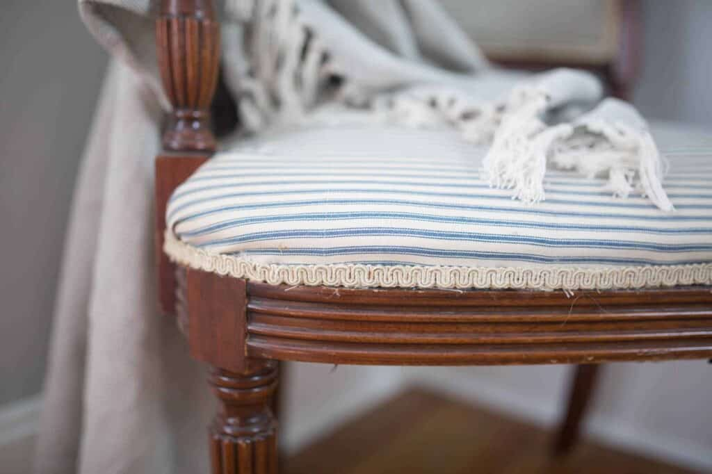 wood reupholster chair with ticking stripe fabric and antique trim