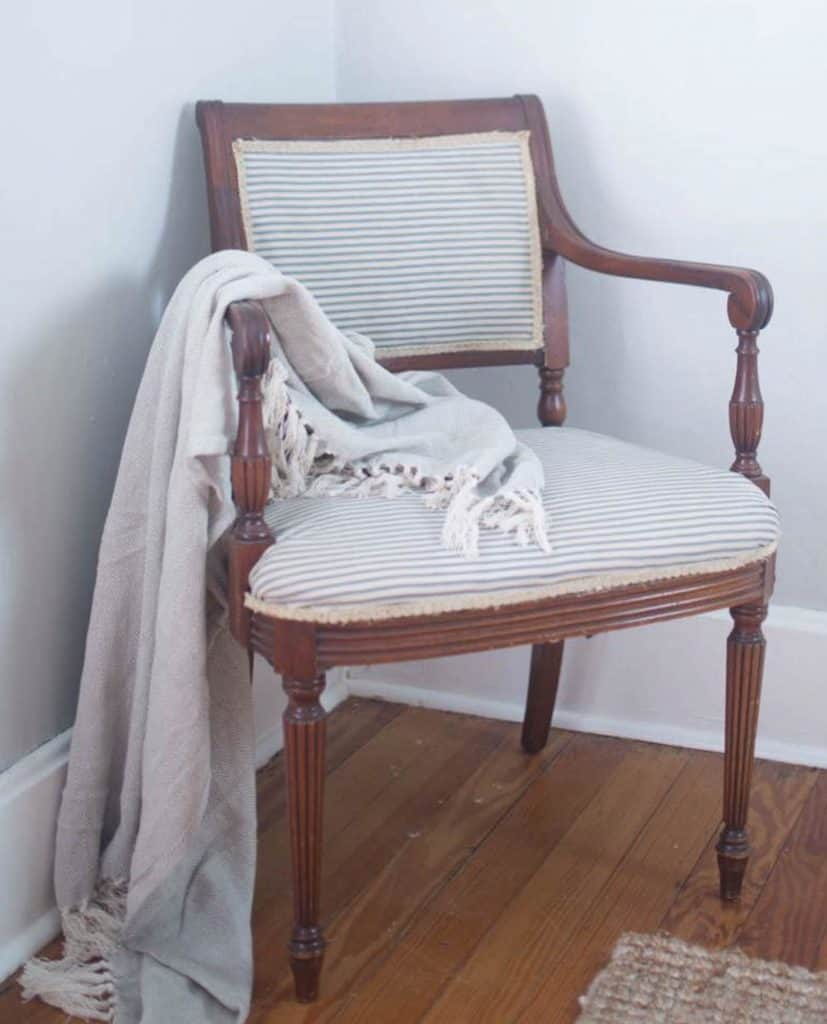 Antique wood chair reupholstered with blue and white ticking stripe - how to reupholster a chair