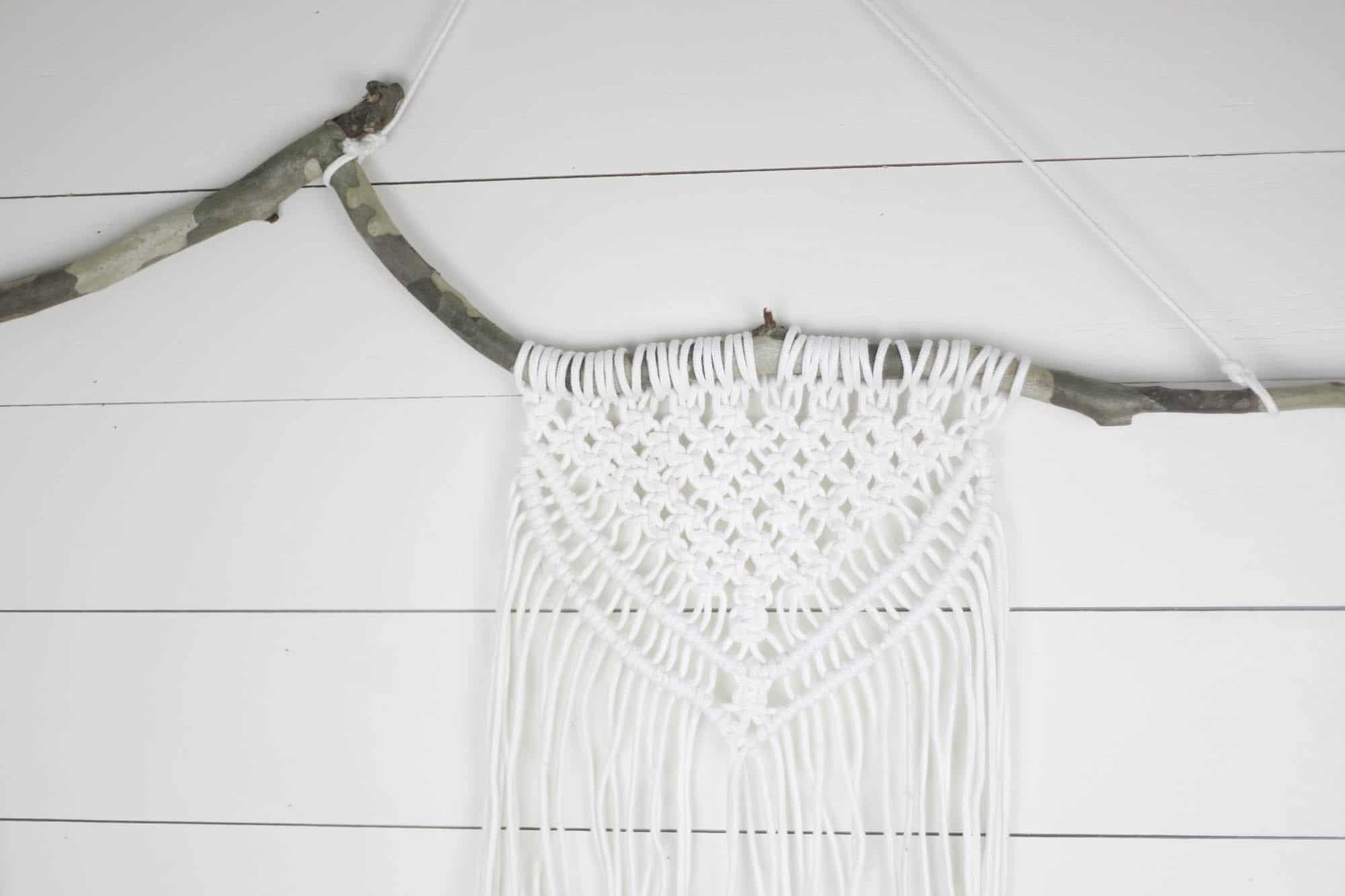 Macrame Wall Hanging using a branch in a diy tutorial