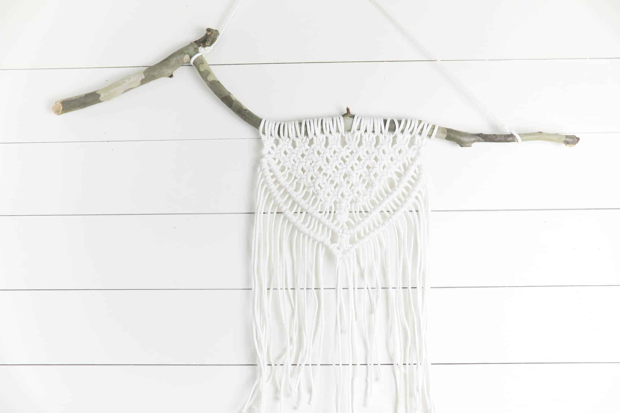 DIY macrame wall hanging on a branch