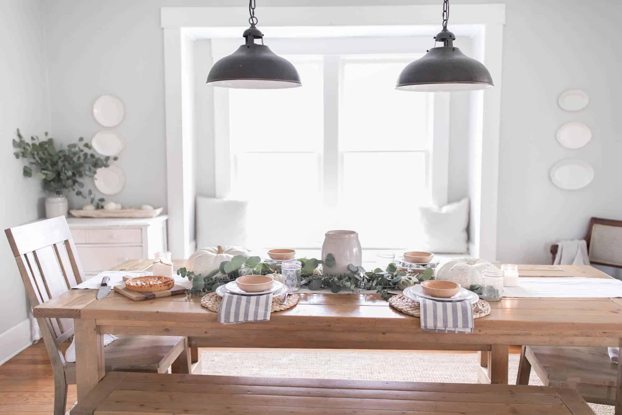 Farmhouse Thanksgiving Tablescape with pumpkins and eucalyptus