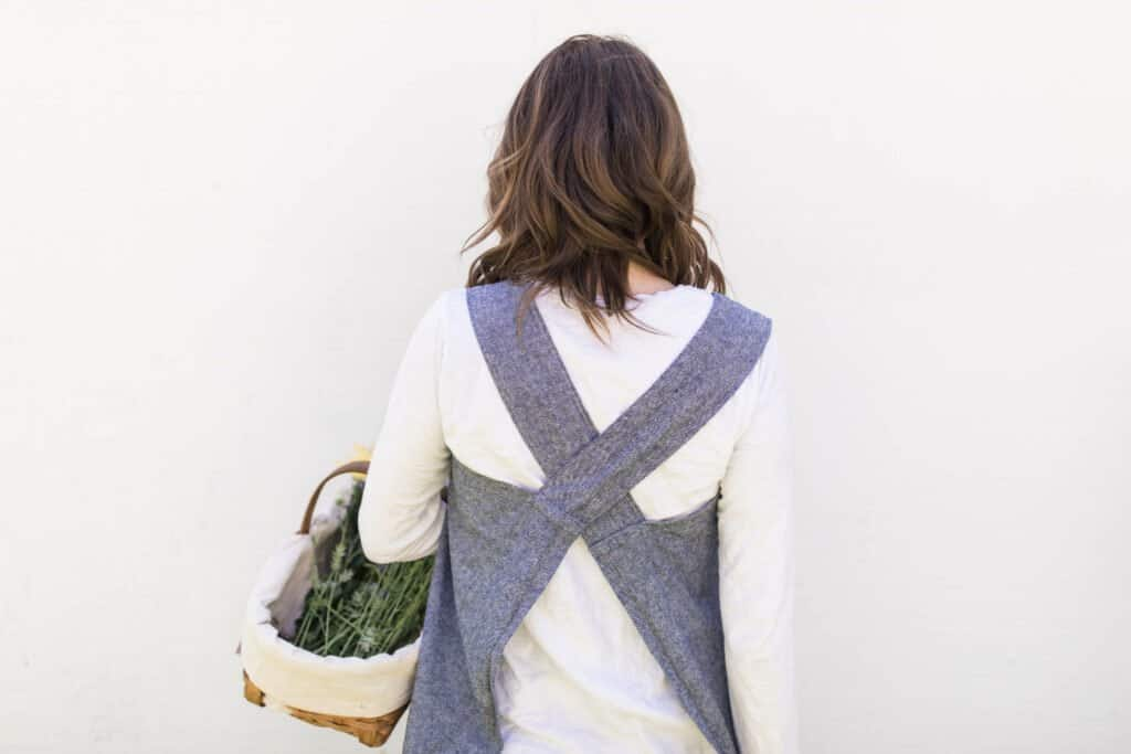 cross back apron back view on woman