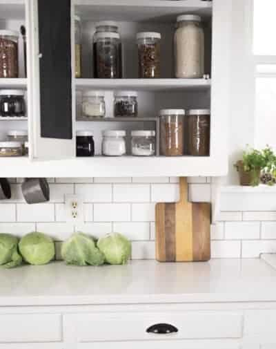Farmhouse Kitchen Cabinet Organization with Mason Jars