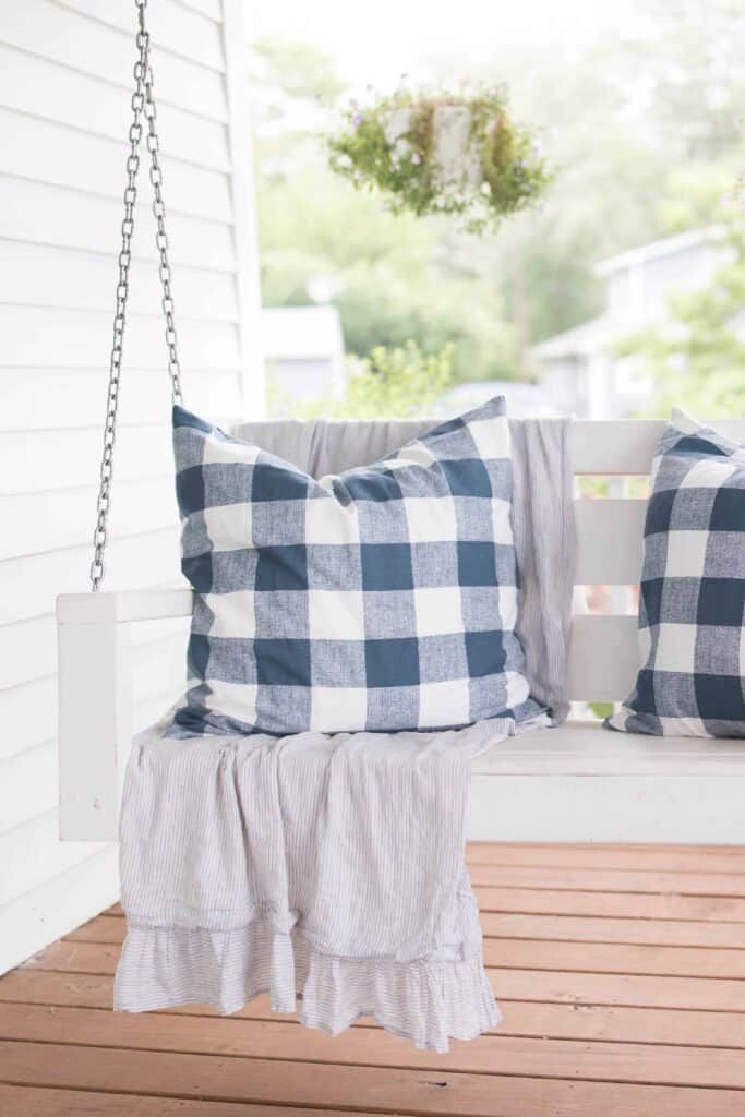 DIY pillows on a porch swing