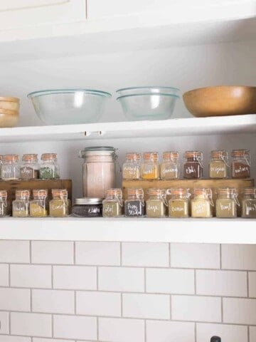 spice cabinet organization with glass spice jars