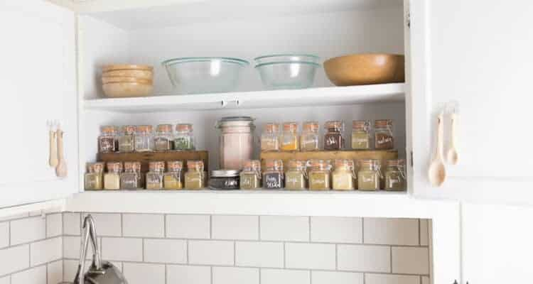 spice cabinet organization with glass spice jars