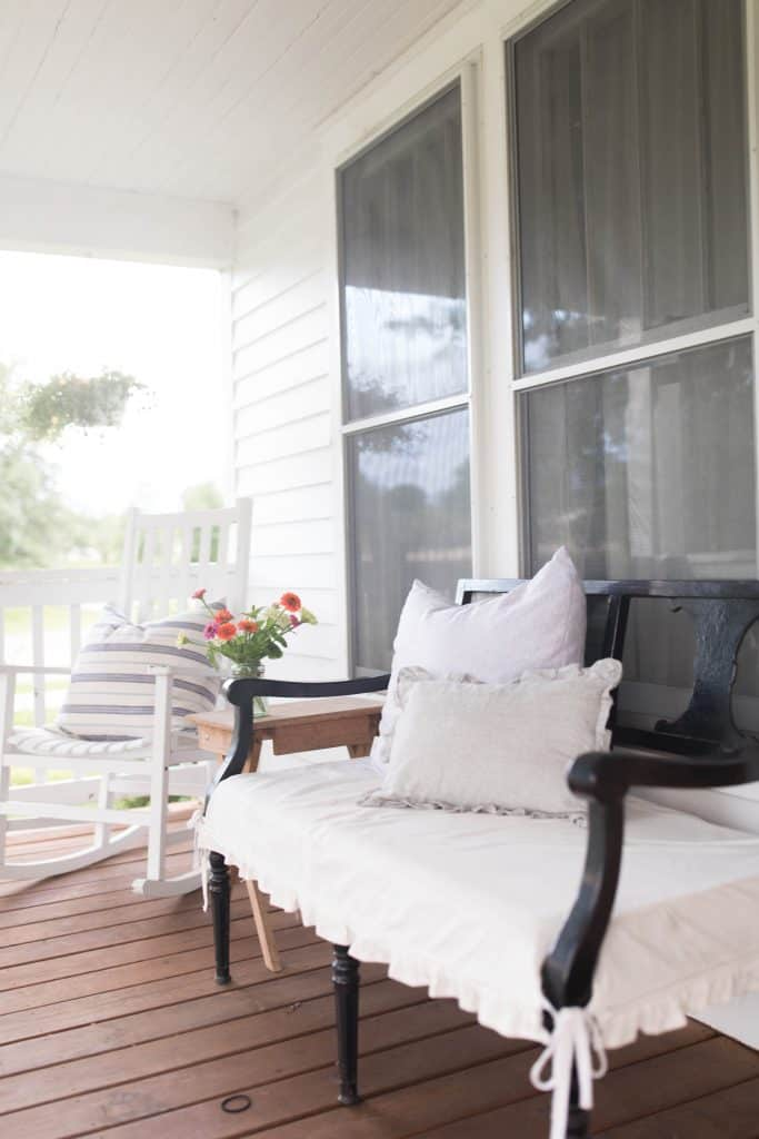 farmhouse front porch white rocking chair antique bench slipcover