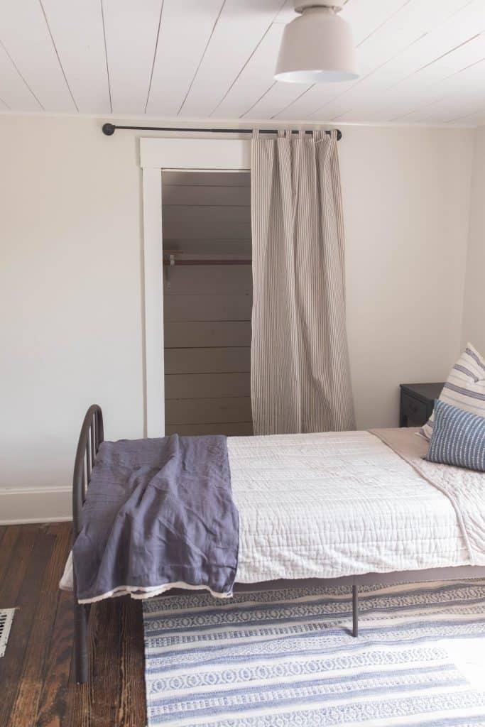 shiplap closet with a curtain ticking stripe