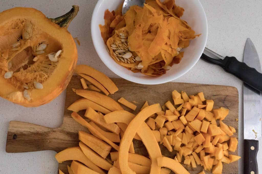 dicing a pie pumpkin for pumpkin sheet pan nachos