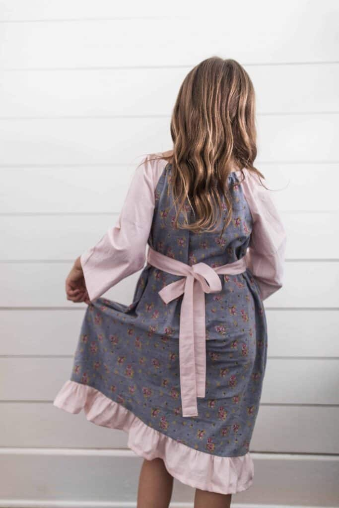 Girl wearing a homemade peasant dress for girls - peasant dress pattern sewing tutorial