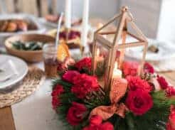 vibrant roses and rustic lantern Christmas centerpiece