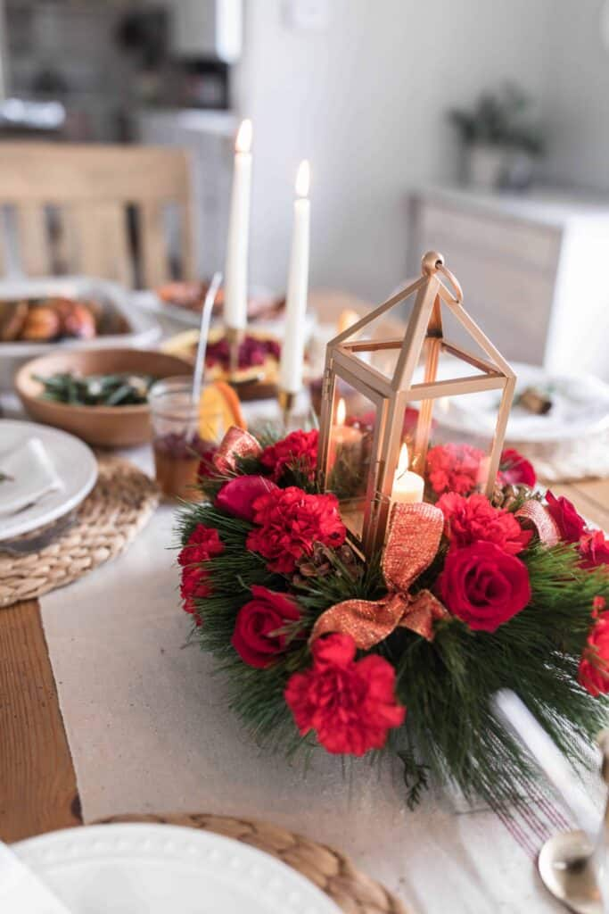 This holiday flower arrangement from FTD Flowers is the perfect way to bring a beautiful table together for hosting a crowd, or just for a special family dinner. Visit the link in the post for 20% off your own arrangement. #farmhouseonboone #FTDFlowers #SayMoreWithFlowers #christmas #christmasdinner #christmastablesetting #christmastable #AD