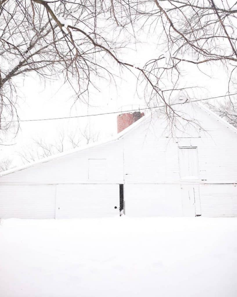 19th century white barn in the snow farmhouse on boone homestead