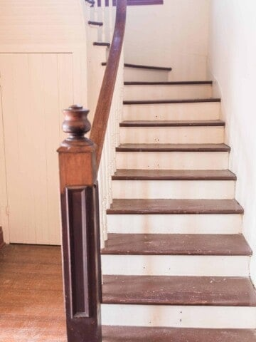 painted staircase in old victorian farmhouse