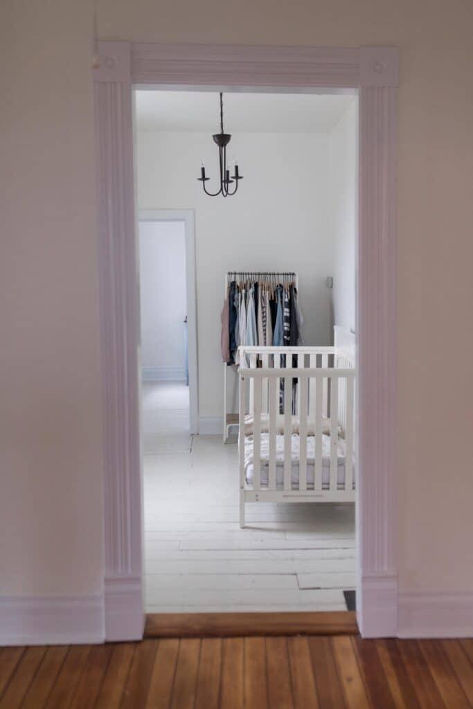 farmhouse nursery painted wood floors benajmin moore white dove paint