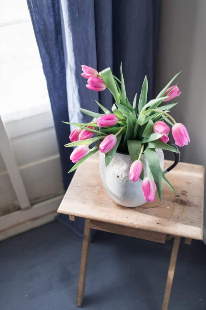 farmhouse mudroom pink tulips wooden antique table