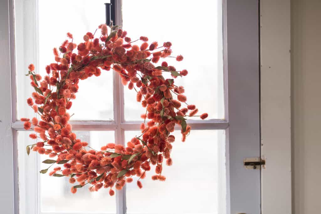 orange wreath farmhouse mudroom