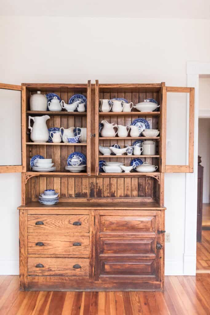 blue china and antique hutch