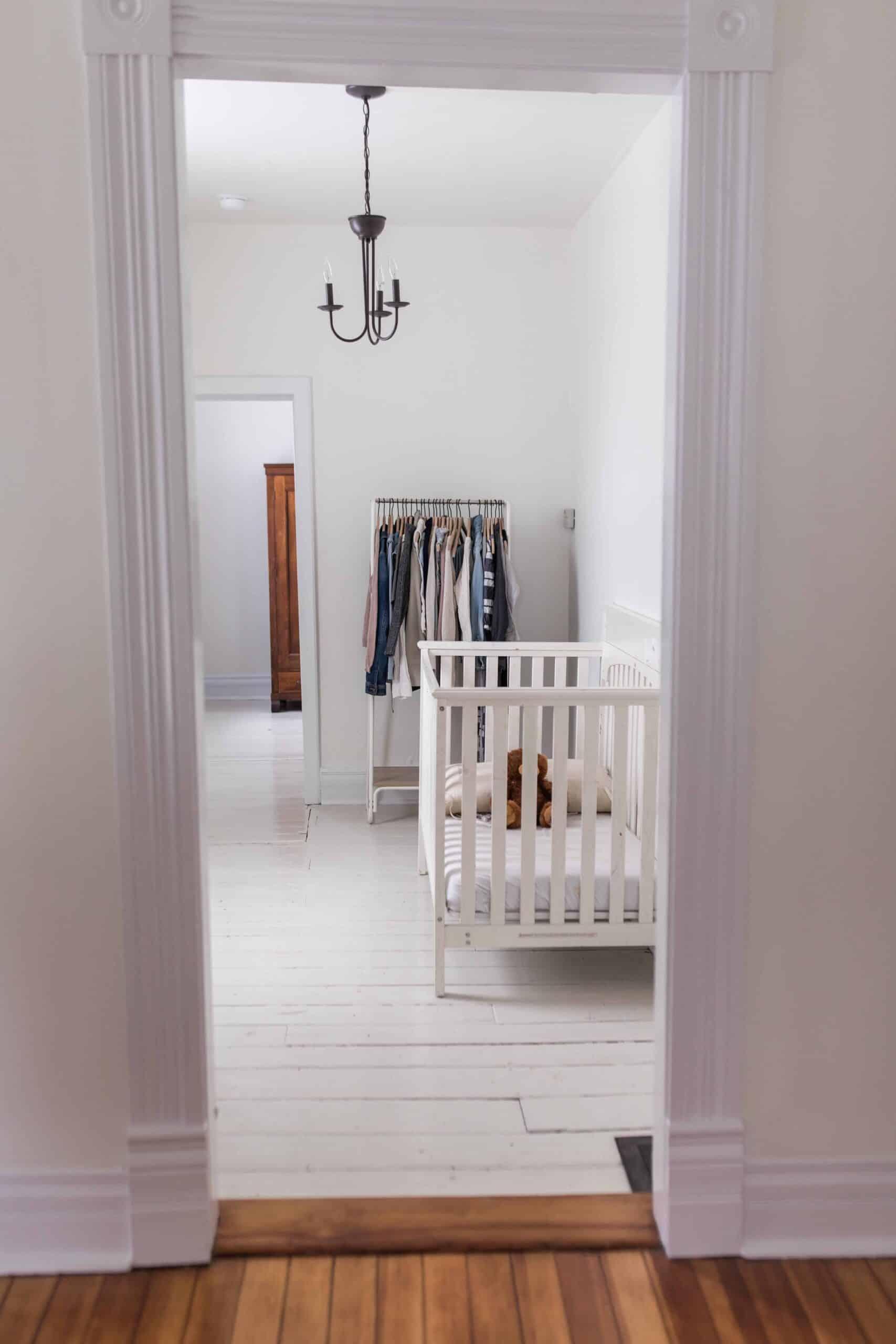 painted white hardwood floors in farmhouse nursery
