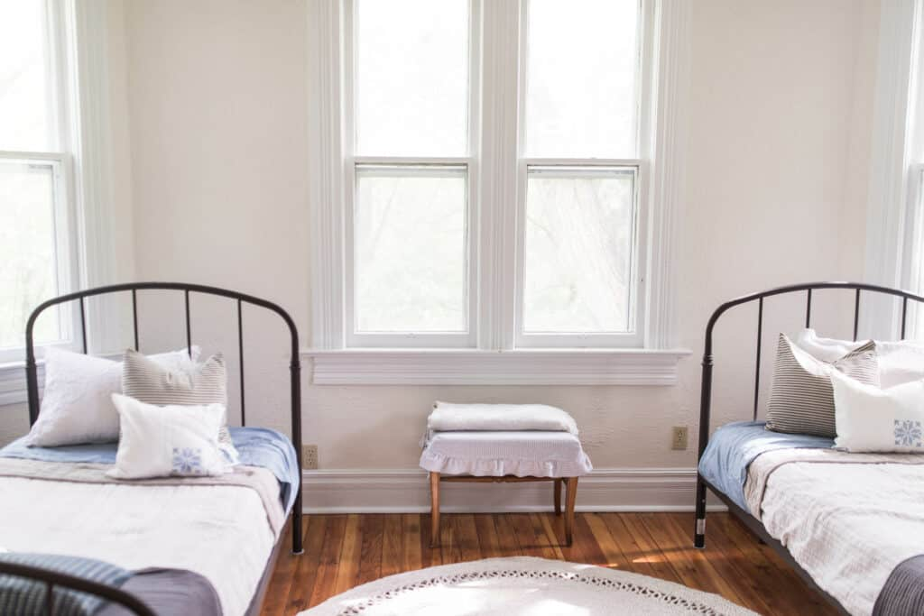 farmhouse boys room iron beds