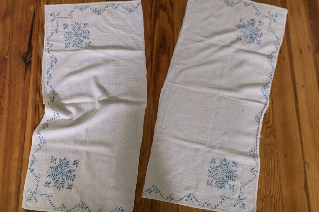 blue embroidered vintage table cloth cut in half to make farmhouse pillow covers