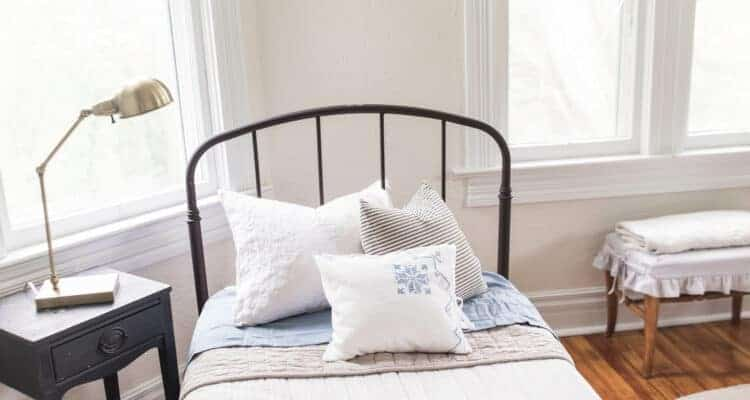 farmhouse boys room makeover brass task lamp and vintage bedding