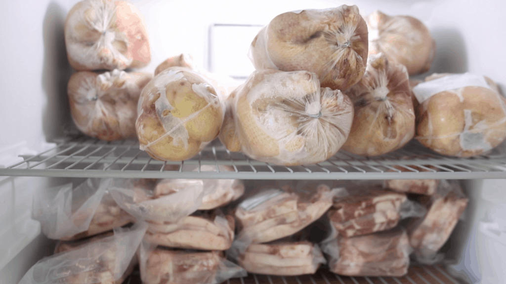 frozen organic chicken and pork in the freezer