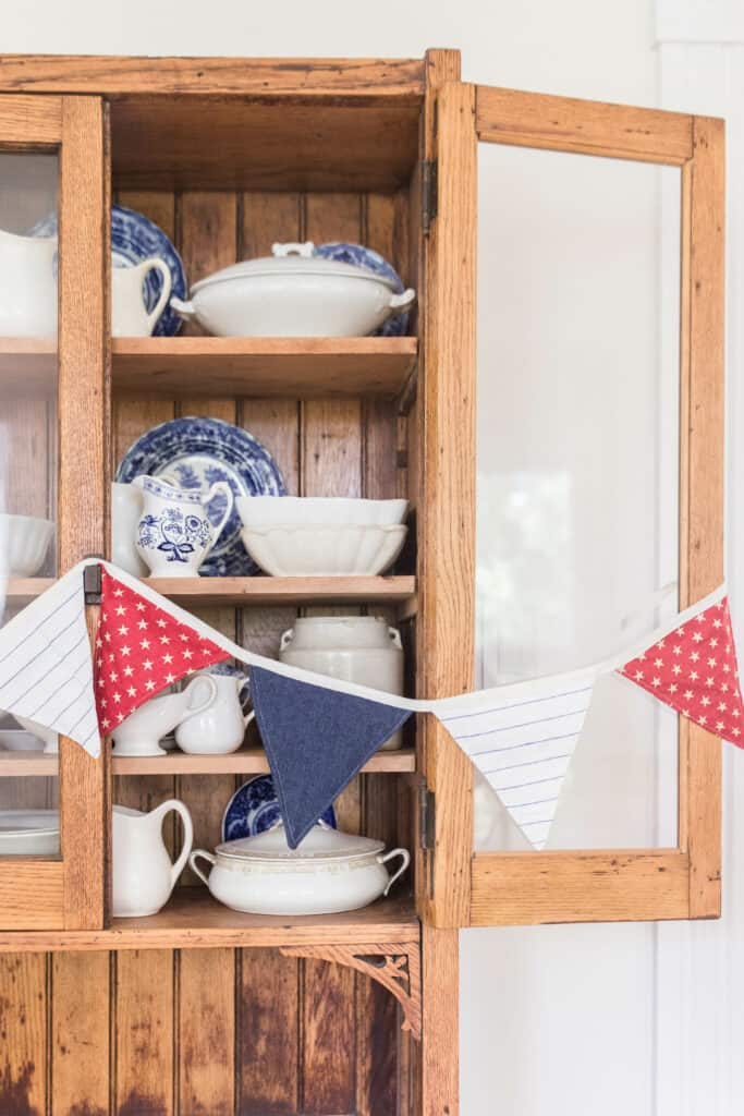 close up fourth of july bunting on vintage hutch