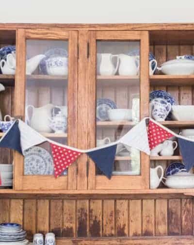red white and blue bunting on hutch with china