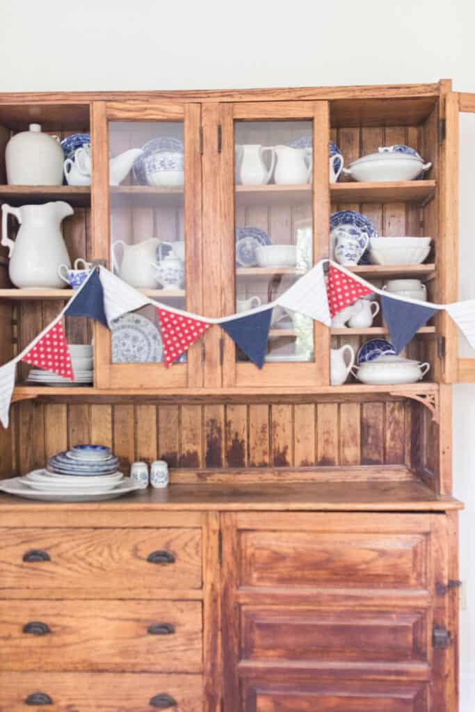 fabric bunting on antique hutch