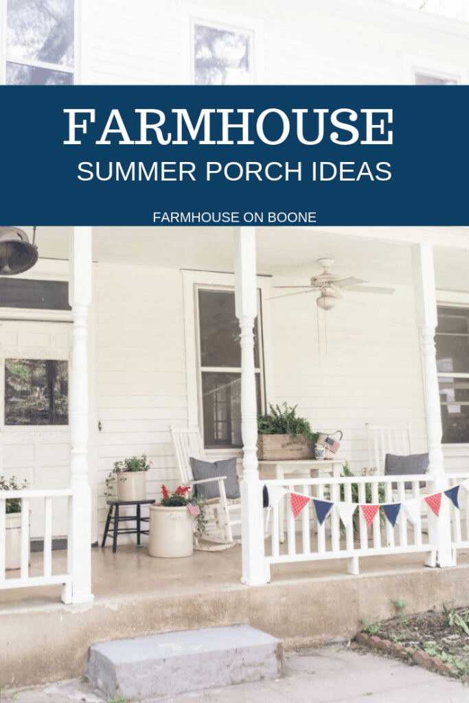 Farmhouse front porch with white furniture, ferns, vintage crocks and crates
