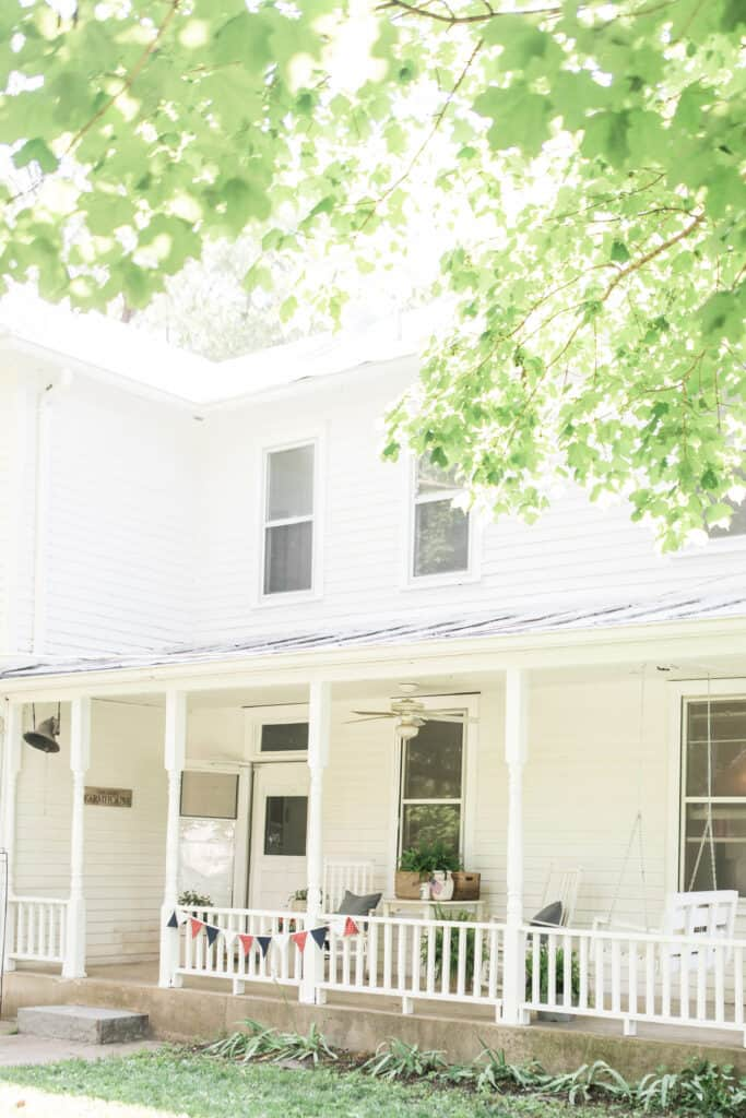 farmhouse front porch decorated for summer