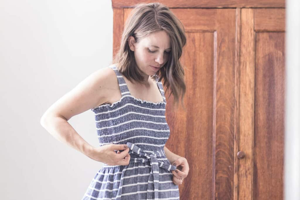 women wearing a blue and white stripped DIY shirred dress