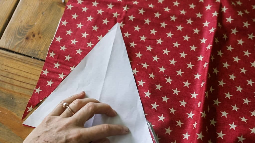 cutting out red stars fabric triangle
