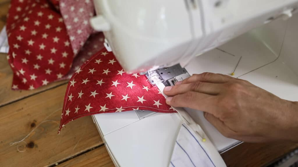 Sewing fabric stars to bais tape for DIY fabric bunting