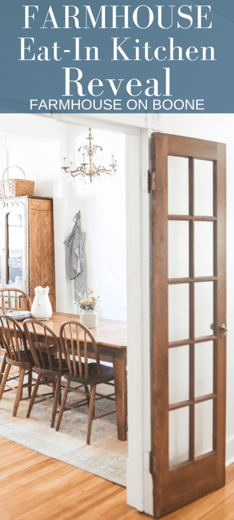 a open wood french door looking into the farmhouse eat-in kitchen with a wood table and chairs and antique hutch