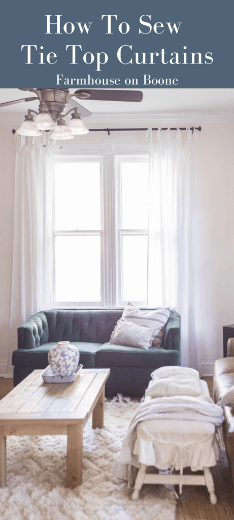 white tie top curtains in a living room with a leather couch, green loveseat and coffee table