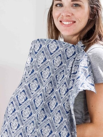 women wearing a blue and white paisley patterned DIY nursing cover