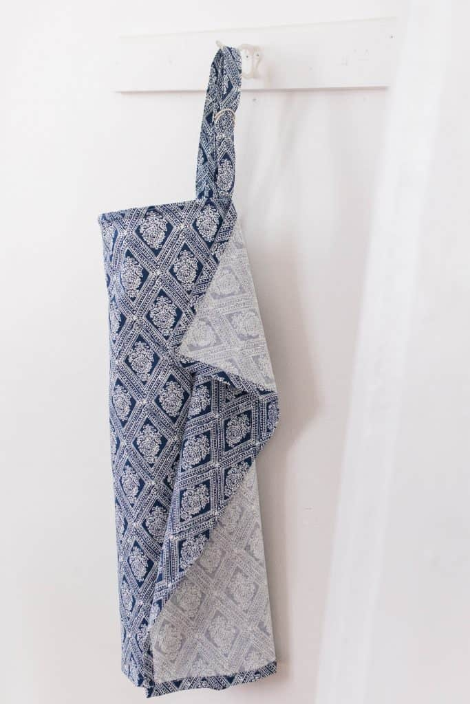 DIY nursing cover hanging on a white wooden coat rack