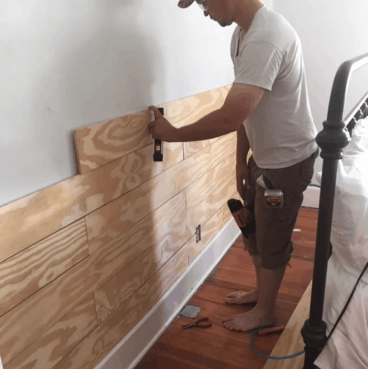Learn how to make an easy diy shiplap wall with this tutorial. Use plywood to make it the inexpensive way.