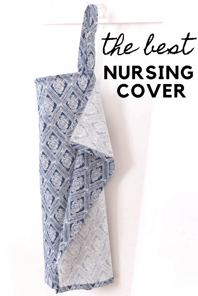 a blue and white nursing cover with wire handing up on a white hook