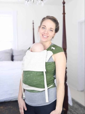 women smiling while wearing a DIY Mei Tai Baby carrier with a baby in it
