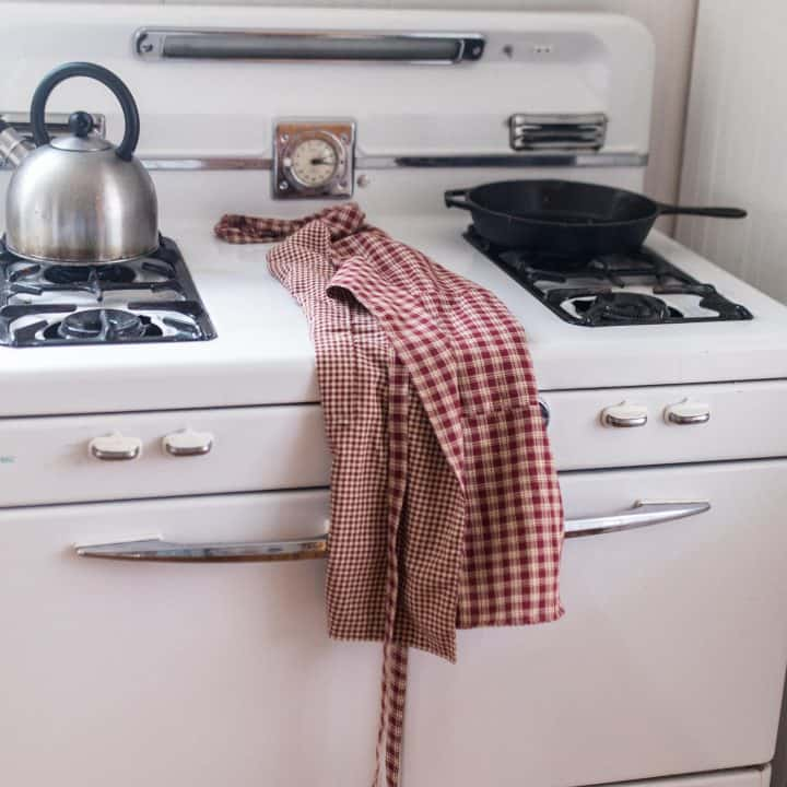 diy reversible apron on a white antique stove