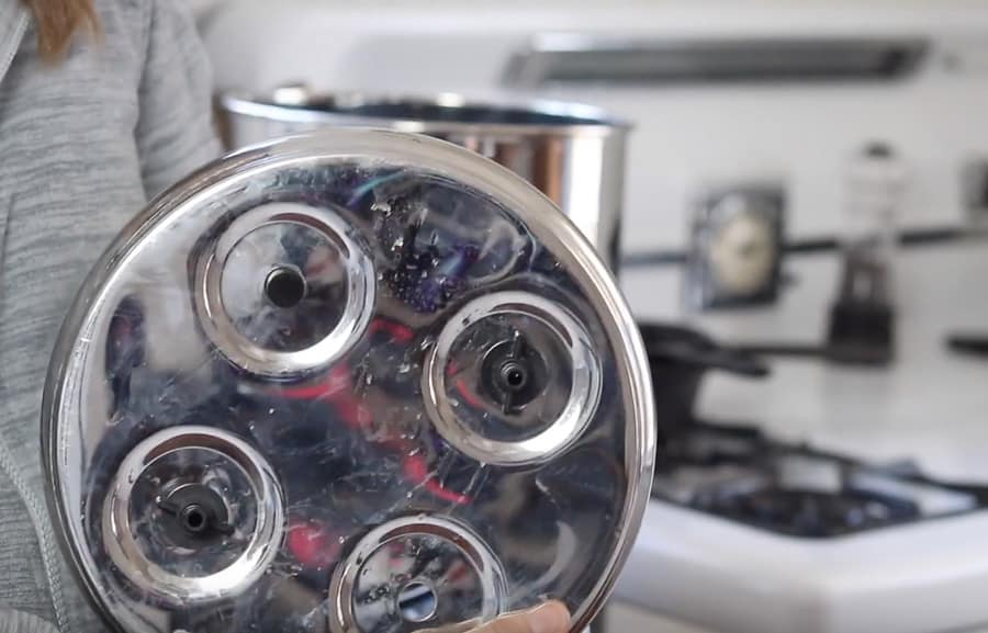 adding stoppers to the open holes of the Berkey water filter