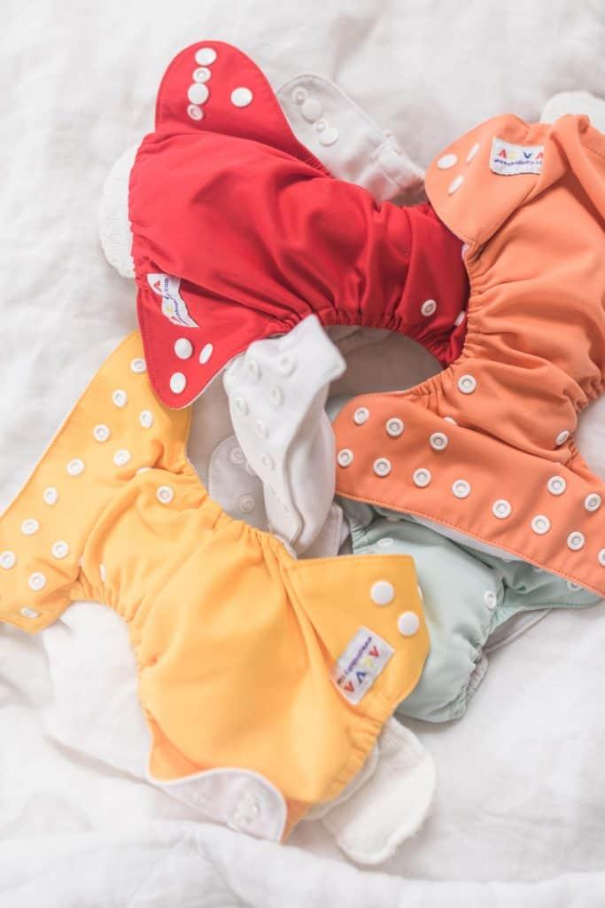 stuffed newborn pocket diapers on a blanket