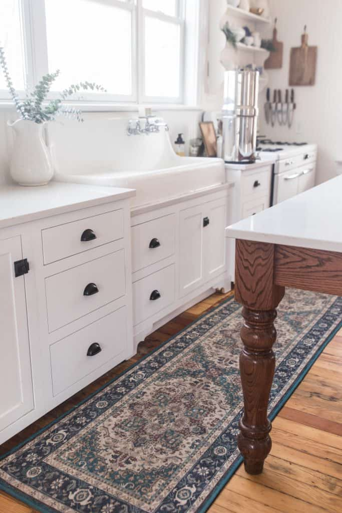 white custom cabinetry topped with white and gray quarts countertops.
