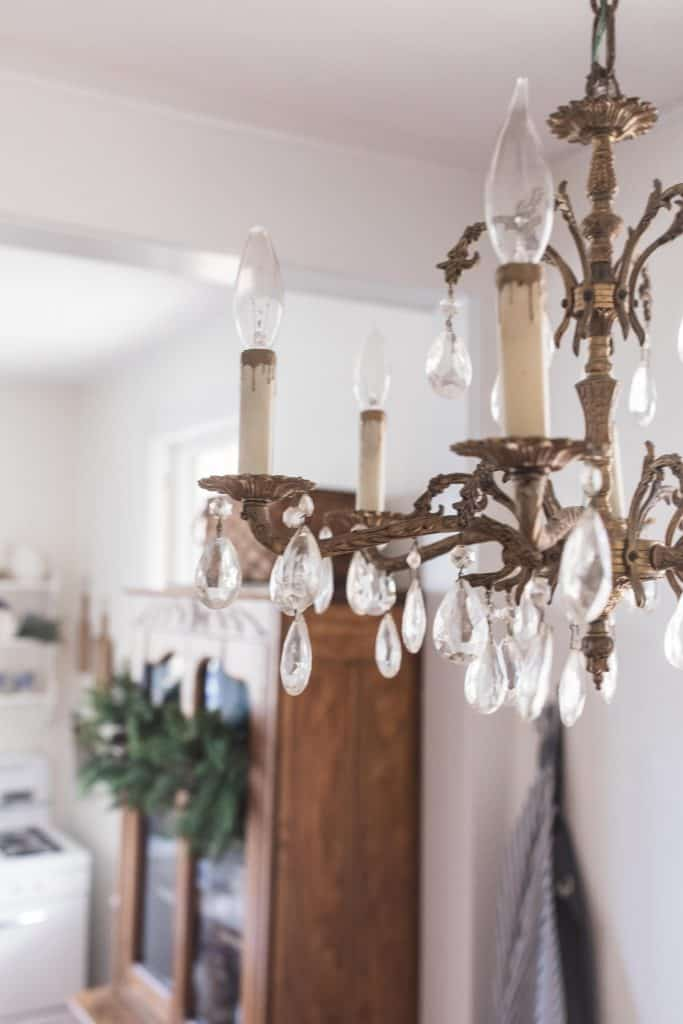 antique brass chandelier hanging in a kitchen eat-in area