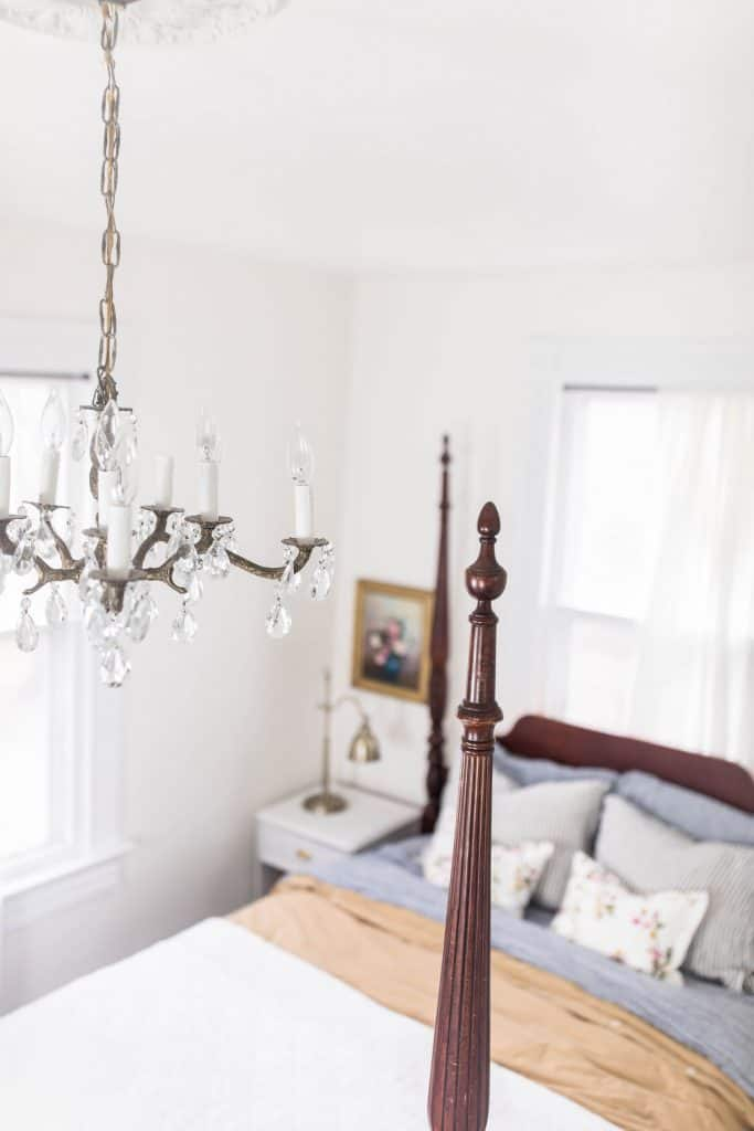 overhead shot of a victorian bedroom with a antique chandelier