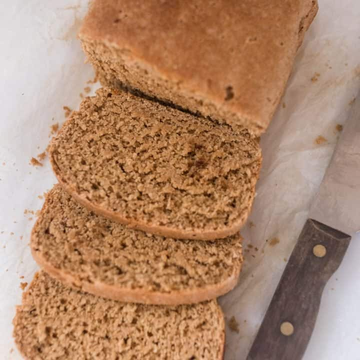 einkorn sandwich bread sliced up with a knife to the right