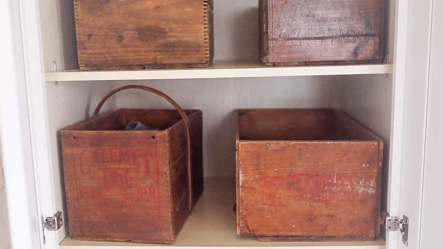 antique wooden bins for shoes in a farmhouse mud room